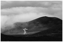 Radio telescope and clouds. Mauna Kea, Big Island, Hawaii, USA ( black and white)