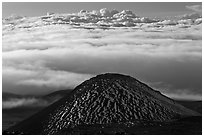 Dark cinder cone and sea of clouds. Mauna Kea, Big Island, Hawaii, USA ( black and white)