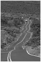 Car on winding Pilani Highway. Maui, Hawaii, USA ( black and white)