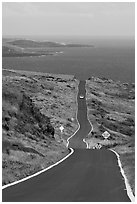 One-lane road overlooking ocean. Maui, Hawaii, USA ( black and white)
