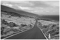 Road across arid landscape. Maui, Hawaii, USA ( black and white)