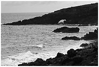 Dark coastline with sea tunnel. Maui, Hawaii, USA ( black and white)