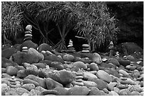Rock piles on Hanakapiai Beach. Kauai island, Hawaii, USA (black and white)