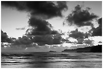 Clouds at sunrise over Kalihiwai Bay. Kauai island, Hawaii, USA ( black and white)