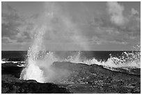 Spouting Horn and incoming surf. Kauai island, Hawaii, USA (black and white)