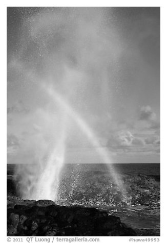 Spouting Horn with rainbow in spray. Kauai island, Hawaii, USA