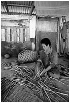 Woman weaving a toga (mat) out of pandamus leaves. American Samoa (black and white)
