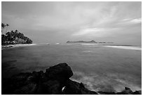 Sunset over Aunuu island with crab on basalt rock. Aunuu Island, American Samoa (black and white)