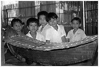 Boys with a traditional musical instrument. Phnom Penh, Cambodia (black and white)