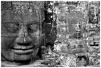 Serene and massive stone faces, the Bayon. Angkor, Cambodia (black and white)