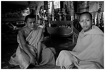 Buddhist novice monks inside temple. Luang Prabang, Laos ( black and white)