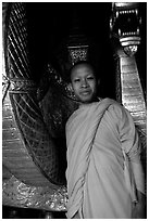 Buddhist novice monk, grinning because demonstrating ordained monks style of robe draping. Luang Prabang, Laos (black and white)