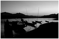 Boats, sunset on the Mekong river. Luang Prabang, Laos ( black and white)