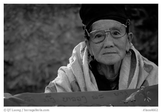 Older woman wears a mix of tribal and western garb. Luang Prabang, Laos (black and white)