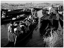 Children commuting to school on small boat. Inle Lake, Myanmar ( black and white)