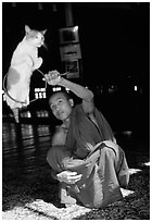 Jumping cat and monk. Inle Lake, Myanmar (black and white)