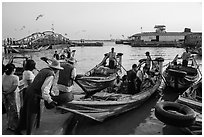 Passengers on oared water taxi crossing Yangon River. Yangon, Myanmar ( black and white)