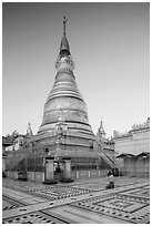Man praying at main stupa of Soon U Ponya Shin Pagoda. Myanmar ( black and white)