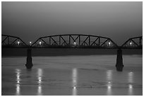 Ava Bridge over Ayeyarwady river at dusk, Sagaing. Myanmar ( black and white)