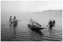 Group of Intha fishermen on misty waters. Inle Lake, Myanmar ( black and white)