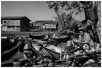 Market, boats, and village houses on stilts. Inle Lake, Myanmar ( black and white)