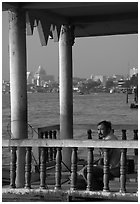 Man fishing on the Chao Phraya river. Bangkok, Thailand ( black and white)