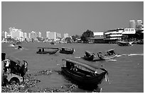 Chao Phraya river crowded with boats. Bangkok, Thailand ( black and white)