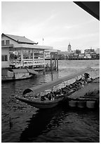Evening commute, long tail taxi boat on Chao Phraya river. Bangkok, Thailand ( black and white)