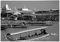Flotilla of boats on the Chao Phraya river. Bangkok, Thailand ( black and white)
