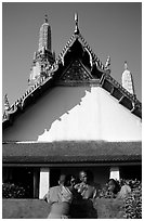 Monks outside Wat Arun. Bangkok, Thailand ( black and white)