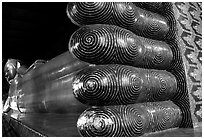 Largest reclining Budhha in Thailand, in Wat Pho. Bangkok, Thailand (black and white)