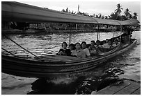 Evening commute, long tail taxi boat on canal. Bangkok, Thailand ( black and white)