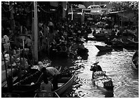 Woman paddling, floating market. Damonoen Saduak, Thailand (black and white)