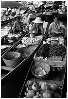 Small boats loaded with food, Floating market. Damonoen Saduak, Thailand (black and white)