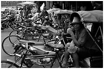 Tricycle drivers. Nakhon Pathom, Thailand ( black and white)
