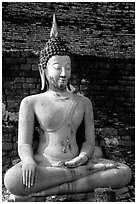 Classic sitting Buddha image, with boneless style typical of period. Sukothai, Thailand ( black and white)