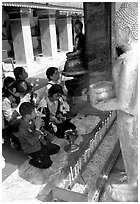 Worshipers at Wat Phra That Doi Suthep, the North most sacred temple. Chiang Mai, Thailand ( black and white)