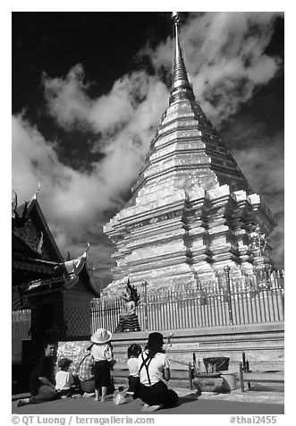 Worshipers at the Chedi of Wat Phra That Doi Suthep. Chiang Mai, Thailand (black and white)