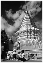 Worshipers at the Chedi of Wat Phra That Doi Suthep. Chiang Mai, Thailand ( black and white)