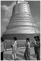 Worshippers circle around chedi. Bangkok, Thailand ( black and white)