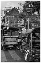 Tuk Tuks and signs. Bangkok, Thailand ( black and white)