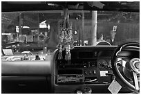 Bus dashboard with religious items. Thailand ( black and white)