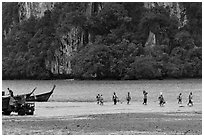 Disembarking at low tide, Rai Leh East. Krabi Province, Thailand (black and white)