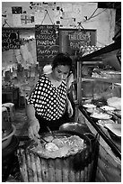 Woman preparing Pad Thai, Phi-Phi island. Krabi Province, Thailand ( black and white)