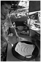 Man preparing thai pancake, Tonsai village, Ko Phi Phi. Krabi Province, Thailand ( black and white)