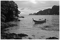 Boat, clear water, stormy skies, Phi-Phi island. Krabi Province, Thailand ( black and white)