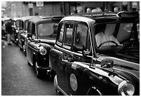 Black London cabs. London, England, United Kingdom (black and white)