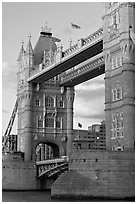 Close view of the Tower Bridge, a landmark 1876 bascule bridge. London, England, United Kingdom ( black and white)