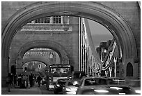 Arches and car traffic on the Tower Bridge at nite. London, England, United Kingdom ( black and white)
