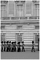 Guards marching during the changing of the Guard, Buckingham Palace. London, England, United Kingdom ( black and white)